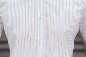 Close up part of a white business shirt on a man