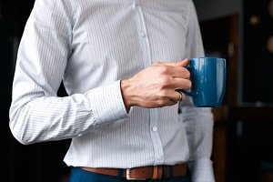 Close up of a businessmans hand with a cup of coffee