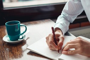 Concept To do list message on notebook with businessman hands