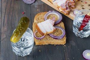 Glass vodka, sandwich with bacon