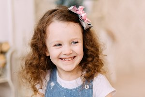 Portrait of cute litlle smiling girl