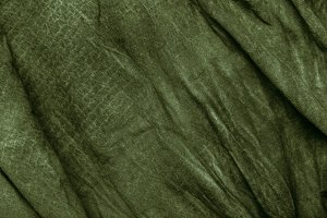 Texture of dark khaki crumpled fabric