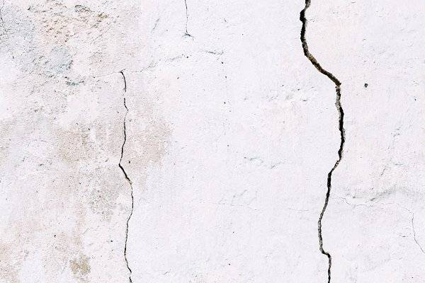 Grunge concrete cement wall with cr…