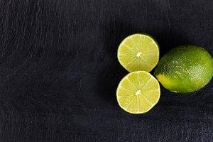 Fresh limes on slate