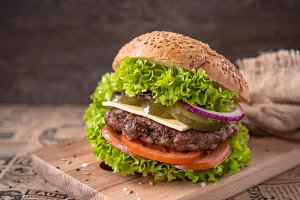 Burger with beef, tomato, cheese