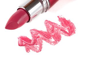 Pink lipstick isolated on white background closeup
