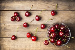 Cherries on the rustic background
