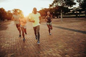 Athletes running at the city park