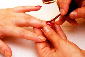 Manicure painting and polishing nails in spa salon
