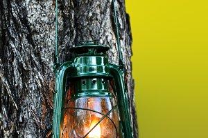Burning lantern in nature