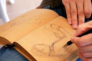 Graphic artist draws sketch picture artwork manual