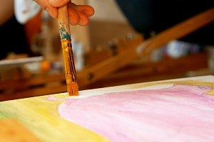 Artist paints picture artwork canvas in art studio