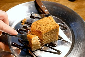 Cake being cut with fork and knife