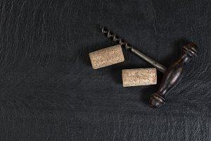 Antique corkscrew with corks