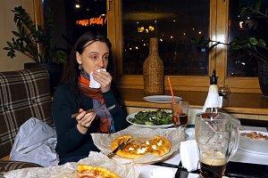 Beautiful woman talks to a friend in a restaurant