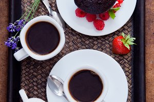 Black coffee and chocolate muffin
