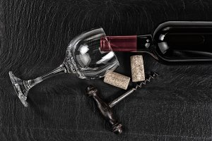 Vintage corkscrew with red wine
