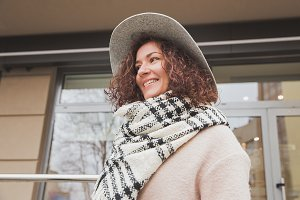 Smiling woman in gray hat