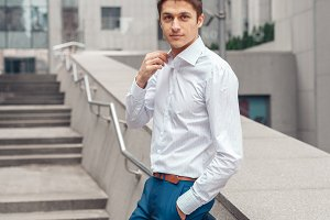 Confident young businessman in white shirt