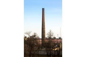 Chimney of factory. Long chimney. Tube.