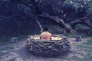 man in nest