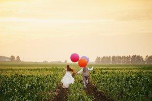 Wedding couple running away