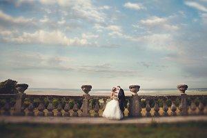 Newlyweds under deep blue sky