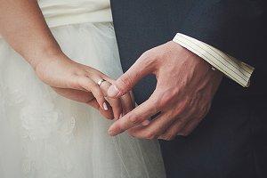 A closeup of newlyweds hands