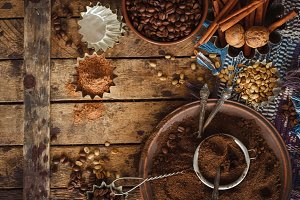 Roasted black and green coffee beans and ground coffee in the plate