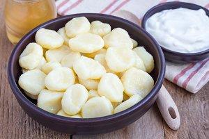 "Traditional russian, ukrainian cottage cheese ""lazy"" dumplings served with yogurt and honey, horizontal"
