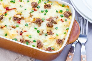 Egg casserole with potatoes, sausage and pepper, in baking dish, horizontal
