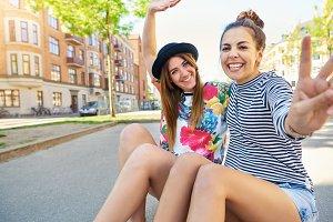 Cute friendly girls waving at the camera