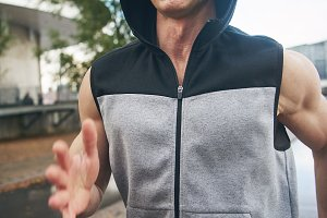 Man jogging in sleeveless hoodie