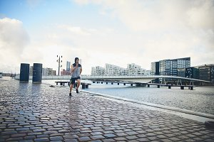 Man jogging on city pavement
