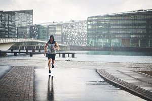 Athletic man jogging in the city