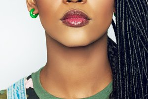 Gorgeous young African woman wearing subtle makeup