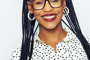 Vivacious young African woman wearing braids