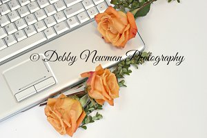 Keyboard and Orange Roses