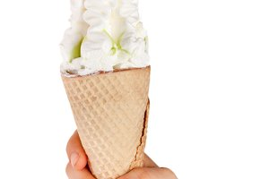 Ice cream cone in child's hand isolated on white background