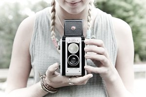 Girl shooting vintage camera!