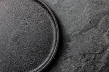 Empty iron plate on slate background