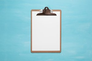 Blank clipboard on pastel blue color background with copy space, minimal style, flat lay