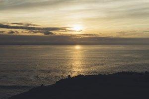 Gold sunset on horizon ocean