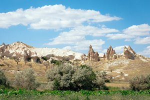 Rock formations landscape photography of Cappadocia in Central Anatolia. The great tourist attraction - mountains in Goreme National Park, outdoor Turkey at sunny summer day