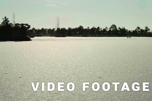 Snowy field on the frozen lake. Clean and frosty daytime. Smooth dolly shot