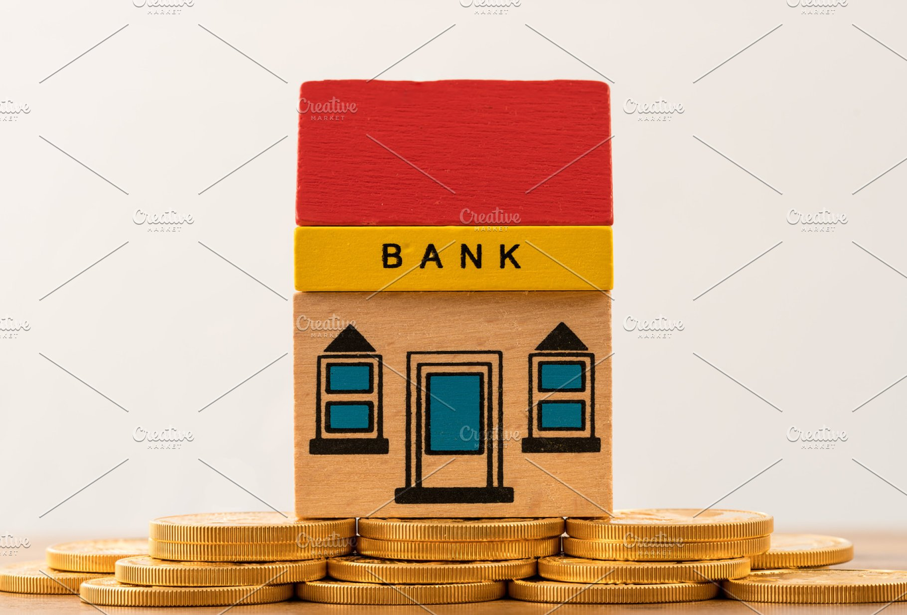 Toy bank building on gold coin assets