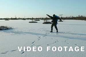 Young man dances on the frozen lake