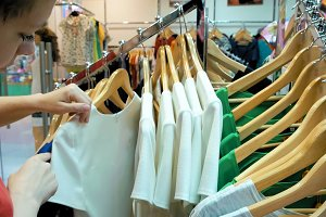 A female customer is browsing through the cloths