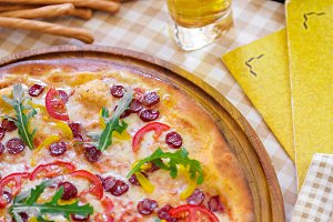 Tasty pizza with glass of beer, on served table