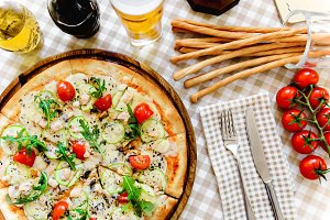 Tasty pizza with glass of beer and thin baguette